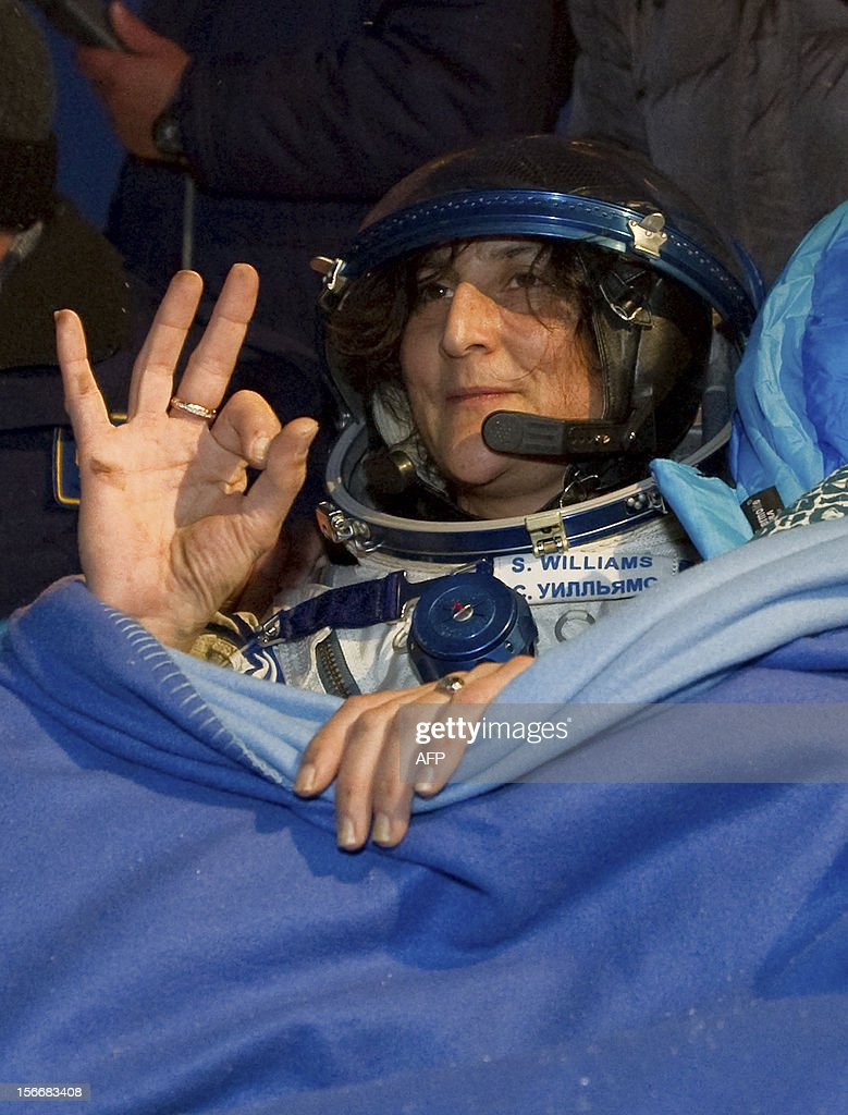 A crew member of the International Space Station (ISS), US astronaut Sunita Williams, waves shortly after her landing in Soyuz capsule near the town of Arkalyk in northern Kazakhstan, early on November 19, 2012. Russian cosmonaut Yury Malenchenko and two astronauts, Sunita Williams of the US and Akihiko Hoshide of Japan, touched down early today on the steppes of Kazakhstan in a Russian Soyuz capsule after spending over four months aboard the International Space Station (ISS).
