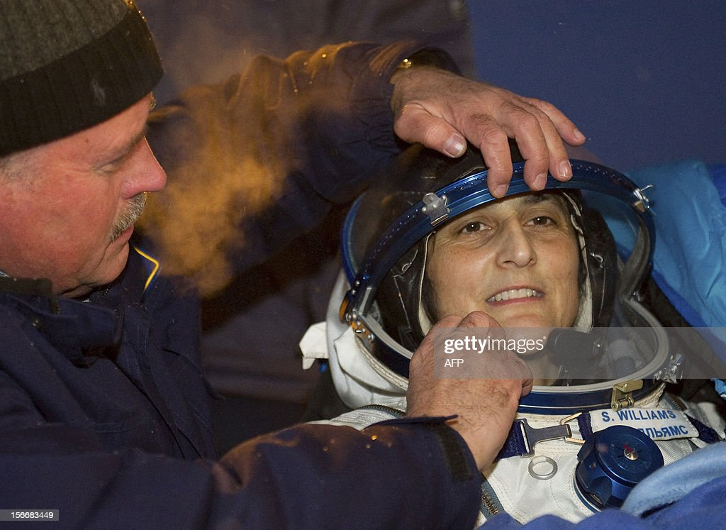 A crew member of the International Space Station (ISS), US astronaut Sunita Williams, is assisted shortly after her landing in Soyuz capsule near the town of Arkalyk in northern Kazakhstan, early on November 19, 2012. Russian cosmonaut Yury Malenchenko and two astronauts, Sunita Williams of the US and Akihiko Hoshide of Japan, touched down early today on the steppes of Kazakhstan in a Russian Soyuz capsule after spending over four months aboard the International Space Station (ISS). AFP PHOTO / POOL / SERGEI REMEZOV