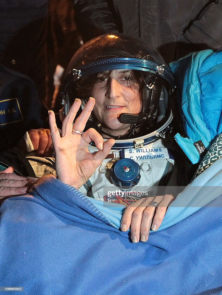 A crew member of the International Space Station (ISS), US astronaut Sunita Williams, gestures shortly after her landing in Soyuz capsule near the town of Arkalyk in northern Kazakhstan, early on November 19, 2012. Russian cosmonaut Yury Malenchenko and two astronauts, Sunita Williams of the US and Akihiko Hoshide of Japan, touched down early today on the steppes of Kazakhstan in a Russian Soyuz capsule after spending over four months aboard the International Space Station (ISS).