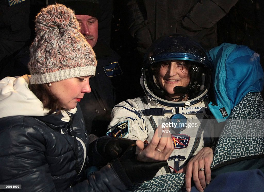 A crew member of the International Space Station (ISS), US astronaut Sunita Williams, smiles shortly after her landing in Soyuz capsule near the town of Arkalyk in northern Kazakhstan, early on November 19, 2012. Russian cosmonaut Yury Malenchenko and two astronauts, Sunita Williams of the US and Akihiko Hoshide of Japan, touched down early today on the steppes of Kazakhstan in a Russian Soyuz capsule after spending over four months aboard the International Space Station (ISS).