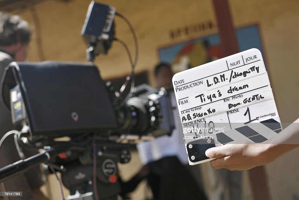 A crew member of the movie 'Tiya's Dream' holds the clapperboard during the shooting of the short film 21 December 2007 in Sululta near Addis Ababa...
