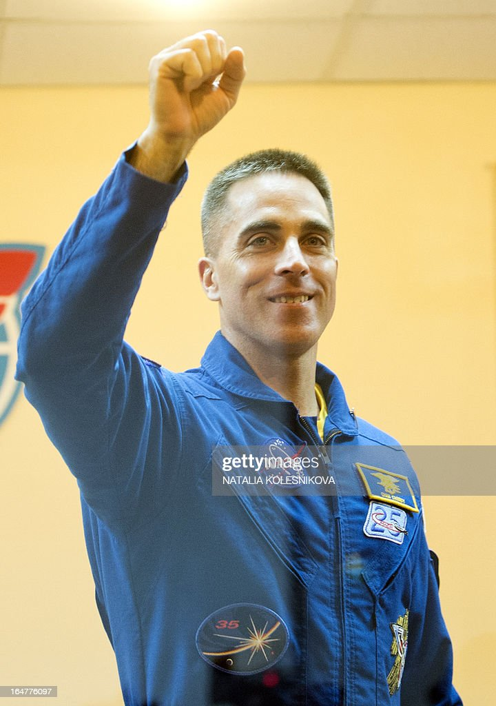 Crew member of the next expedition to the International Space Station (ISS), US astronaut Christopher Cassidy waves to relatives and friends after a press conference at the Russian leased Kazakhstan's Baikonur cosmodrome, on March 27, 2013. The launch of the Soyuz TMA-08M spacecraft with Cassidy, Vinogradov and Misurkin aboard is scheduled on March 29. AFP PHOTO/NATALIA KOLESNIKOVA