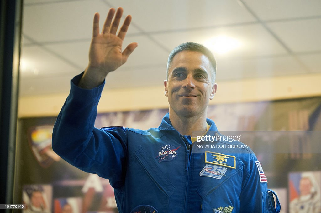 Crew member of the next expedition to the International Space Station (ISS), US astronaut Christopher Cassidy waves to relatives and friends before a press conference at the Russian leased Kazakhstan's Baikonur cosmodrome, on March 27, 2013. The launch of the Soyuz TMA-08M spacecraft with Cassidy, Vinogradov and Misurkin aboard is scheduled on March 29. AFP PHOTO/NATALIA KOLESNIKOVA