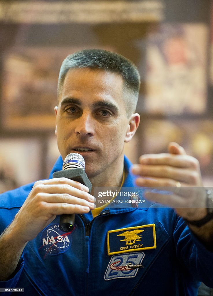 Crew member of the next expedition to the International Space Station (ISS), US astronaut Christopher Cassidy answers questions during a press conference at the Russian leased Kazakhstan's Baikonur cosmodrome, on March 27, 2013. The launch of the Soyuz TMA-08M spacecraft with Cassidy, Vinogradov and Misurkin aboard is scheduled on March 29. AFP PHOTO/NATALIA KOLESNIKOVA