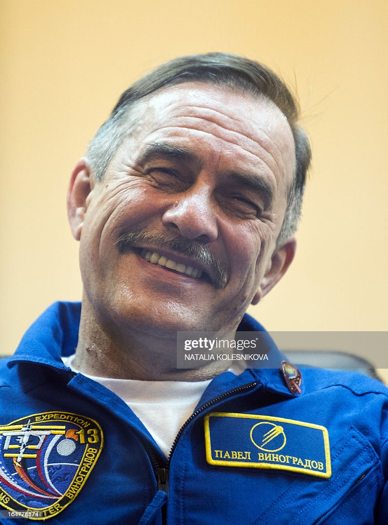 Crew member of the next expedition to the International Space Station (ISS), Russian cosmonaut Pavel Vinogradov smiles as he answers questions during a press conference at the Russian leased Kazakhstan's Baikonur cosmodrome, on March 27, 2013. The launch of the Soyuz TMA-08M spacecraft with Cassidy, Vinogradov and Misurkin aboard is scheduled on March 29. AFP PHOTO/NATALIA KOLESNIKOVA