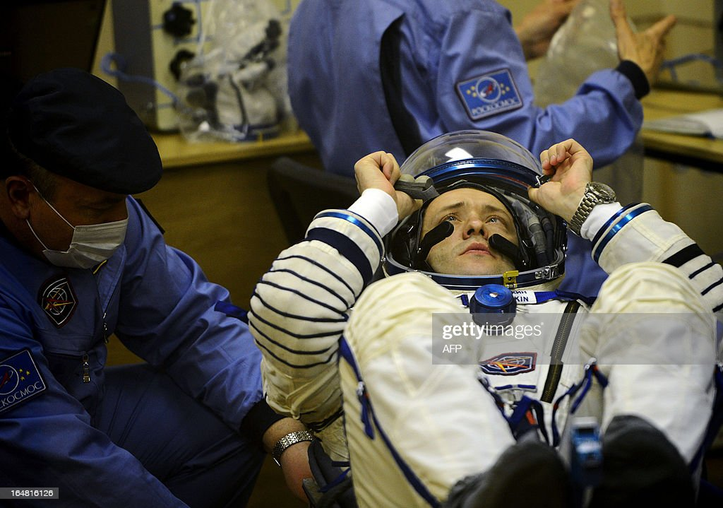 Crew member of the next expedition to the International Space Station (ISS), Russian cosmonaut Alexander Misurkin checks his space suit prior to the launch of the the Soyuz TMA-08M spacecraft at the Russian-leased Baikonur cosmodrome on March 28, 2013. US astronaut Christopher Cassidy, Russian cosmonauts, Pavel Vinogradov and Alexander Misurkin are set to blast off early on March 29 for the International Space Station (ISS) aboard a Soyuz TMA-08M spacecraft.