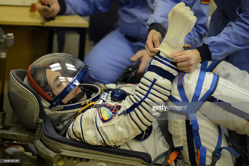 Crew member of the next expedition to the International Space Station (ISS), US astronaut Christopher Cassidy checks his space suit prior to the launch of the the Soyuz TMA-08M spacecraft at the Russian-leased Baikonur cosmodrome on March 28, 2013. US astronaut Christopher Cassidy, Russian cosmonauts, Pavel Vinogradov and Alexander Misurkin are set to blast off early on March 29 for the International Space Station (ISS) aboard a Soyuz TMA-08M spacecraft. The launch of the Soyuz TMA-08M spacecraft with Christopher Cassidy, Pavel Vinogradov and Alexander Misurkin aboard is scheduled on March 29, 2013. AFP PHOTO / POOL / RAMIL SITDIKOV