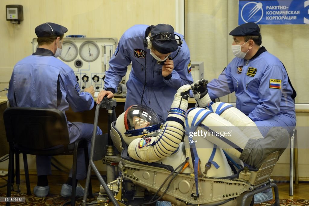 Crew member of the next expedition to the International Space Station (ISS), US astronaut Christopher Cassidy checks his space suit prior to the launch of the the Soyuz TMA-08M spacecraft at the Russian-leased Baikonur cosmodrome on March 28, 2013. US astronaut Christopher Cassidy, Russian cosmonauts, Pavel Vinogradov and Alexander Misurkin are set to blast off early on March 29 for the International Space Station (ISS) aboard a Soyuz TMA-08M spacecraft. The launch of the Soyuz TMA-08M spacecraft with Christopher Cassidy, Pavel Vinogradov and Alexander Misurkin aboard is scheduled on March 29, 2013.