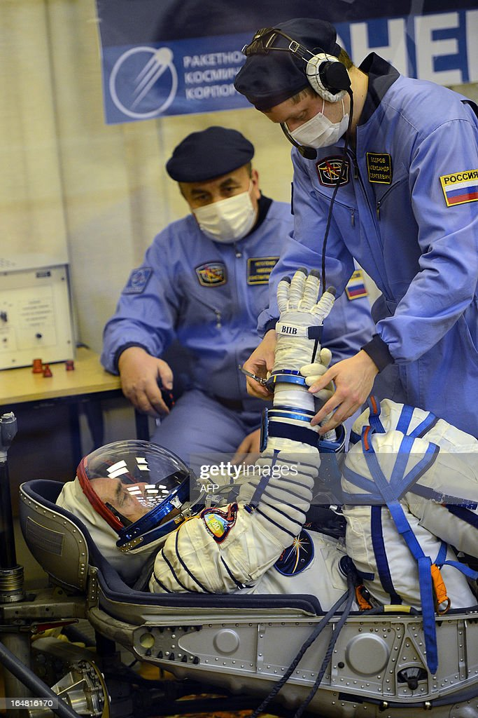Crew member of the next expedition to the International Space Station (ISS), Russian cosmonaut Pavel Vinogradov checks his space suit priorto the launch of the the Soyuz TMA-08M spacecraft at the Russian-leased Baikonur cosmodrome on March 28, 2013. US astronaut Christopher Cassidy, Russian cosmonauts, Pavel Vinogradov and Alexander Misurkin are set to blast off early on March 29 for the International Space Station (ISS) aboard a Soyuz TMA-08M spacecraft.
