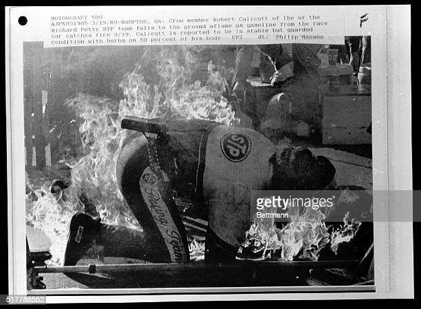 Crew member Robert Calicutt of the Richard Petty's STP team falls to the ground aflame as gasoline from the race car catches fire 3/19 Calicutt is...