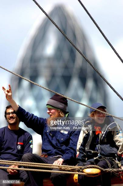 A crew member salutes the onlooking crowd as the Swedish ship Gtheborg a fullscale replica of an 18th Century East India merchantman fires its...