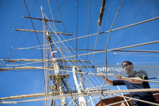 A crew member secures a line on the Norwegian tall ship the Sørlandet as it sits docked at Fan Pier in Boston Apr 9 2017 The tall ship Sorlandet the...