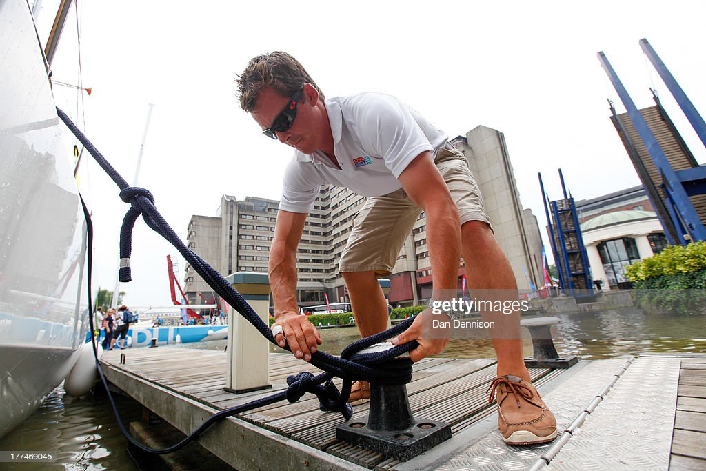 A crew member secures one of the race yachts competing in The Clipper 2013-14 Round The World Yacht Race, as moored in St Katherine's Dock, east London on August 23, 2013. The 40,000 mile, 8-leg course begins on September 1 and will visit six continents, taking eleven months to complete.