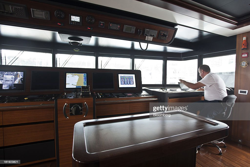 A crew member uses a laptop computer on the bridge of the 49.9-meter superyacht Ileria, built by Proteksan Turquoise, with the interior designed by J G Verges Designn, during the Monaco Yacht Show (MYS) in Monaco, France, on Thursday, Sept. 26, 2013. Over 100 of the world's luxury yachts will be displayed in Port Hercules during the 23rd MYS which runs from Sept. 25 - 28. Photographer: Balint Porneczi/Bloomberg via Getty Images