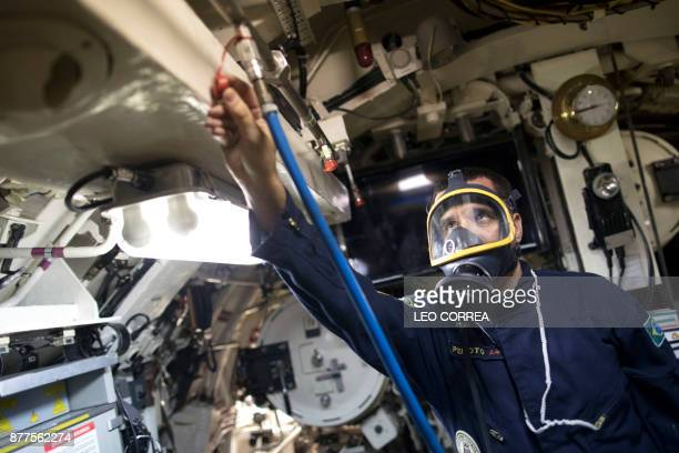 A crew member wears emergency gear during a presentation to the press inside the Brazilian submarine Timbira in Rio de Janeiro Brazil on November 22...