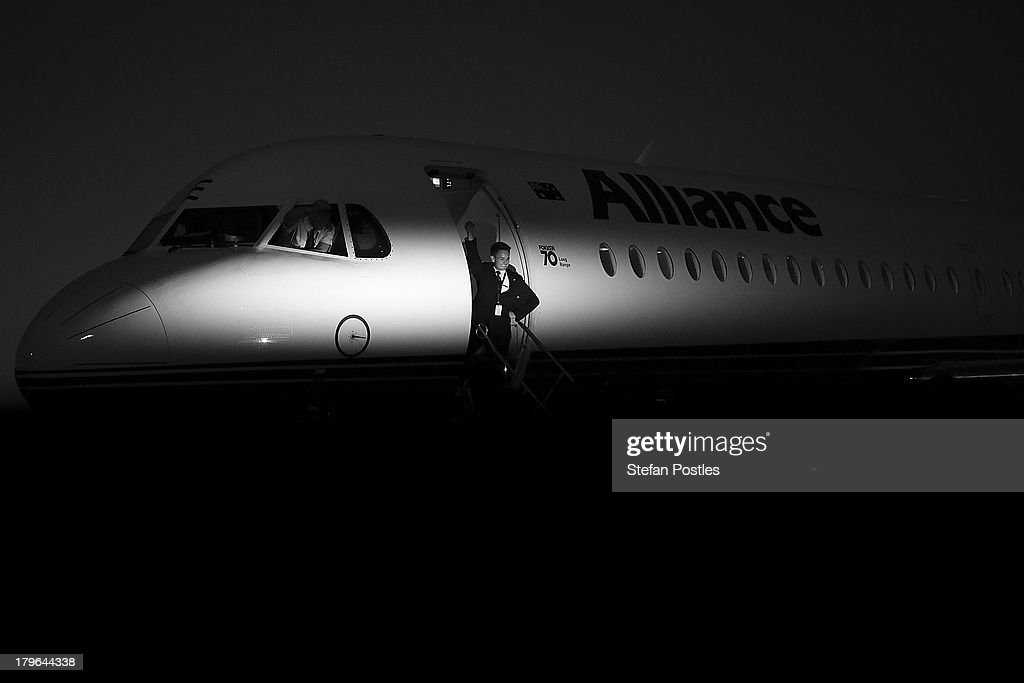 A crew member who has travelled with the media crew for the last couple of weeks farewells them after their last flight together on September 6, 2013 in Brisbane, Australia. Australian voters will head to the polls on September 7 to elect the 44th parliament.