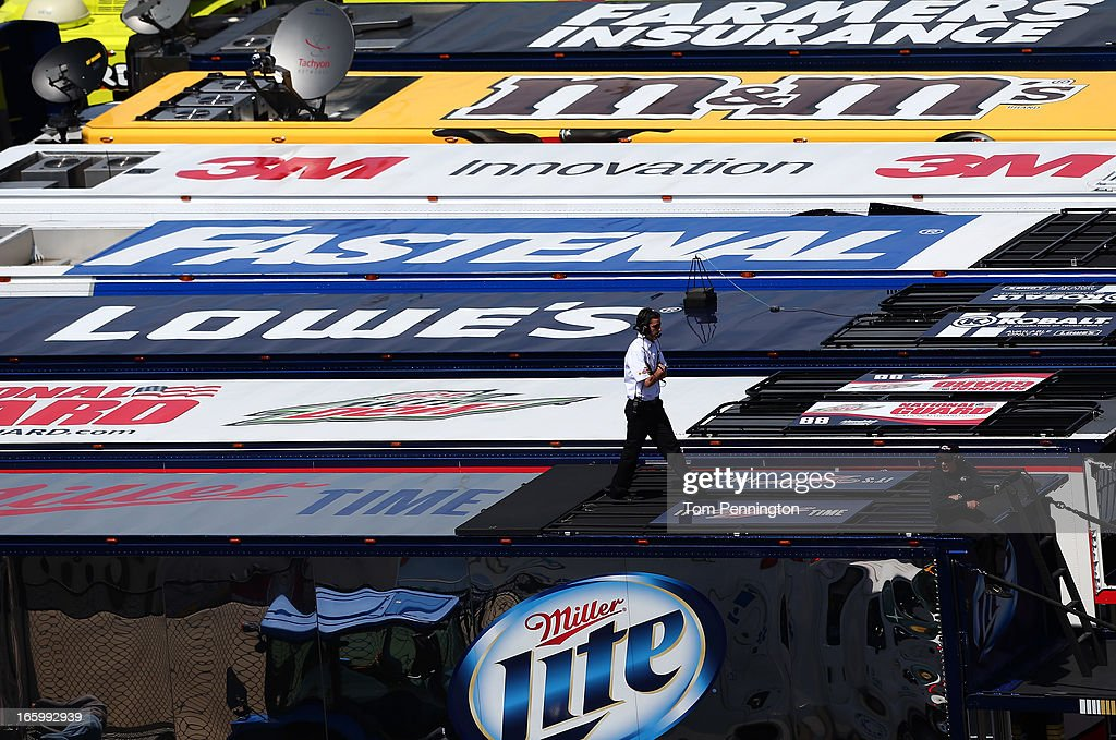 A crew member with Brad Keselowski, driver of the #2 Miller Lite Ford, walks across the team hauler during the NASCAR Sprint Cup Series STP Gas Booster 500 on April 7, 2013 at Martinsville Speedway in Ridgeway, Virginia.