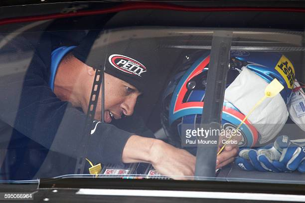 A crew member works on AJ Allmendinger's Best Buy Ford during practice for the NASCAR Sprint Cup Series Auto Club 400