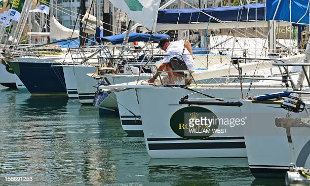 A crew member works on the bow of a yacht as crews prepare for the gruelling Sydney to Hobart yacht race which sets sail on Boxing Day in Sydney on...
