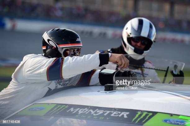 A crew member works on the radio antenna of Brad Keselowski driver of the Miller Lite Ford during the Monster Energy NASCAR Cup Series Alabama 500 at...