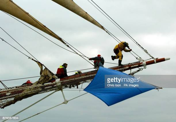 Crew members aboard the tall ship Prince William work on the bowsprit as they match race their sister ship Stavros S Niarchos on the Solent The 60...