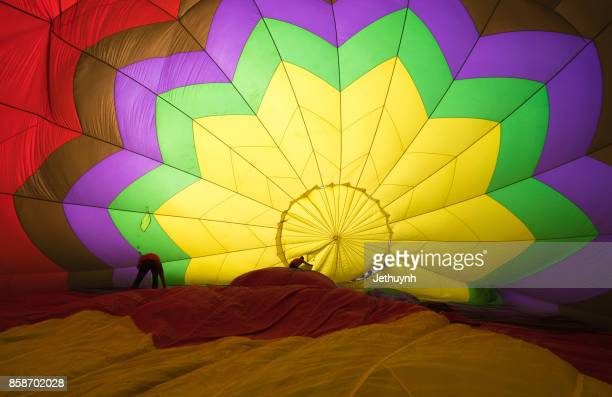 Crew members adjusting a hot air balloon in Ho Chi Minh City