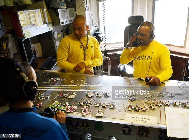 Crew members are seen directing flight operations using the ships 'Ouija Board' on July 14 2017 in Townsville Australia USS Ronald Reagan is a 1092...