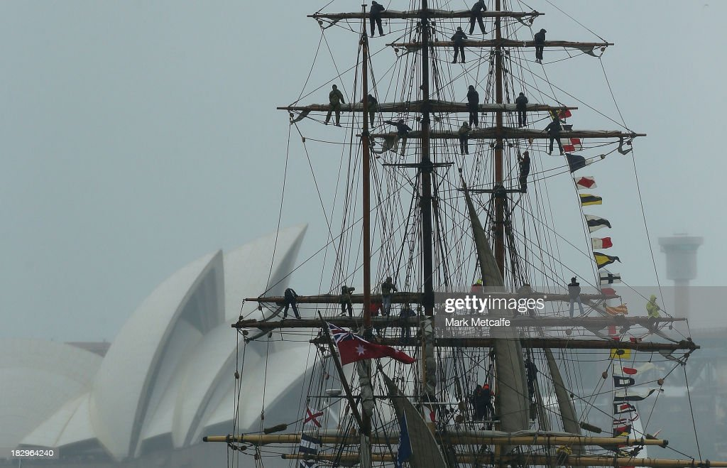 Crew members are seen on a ship's rigging as Tall Ships enter Sydney Harbour on October 3, 2013 in Sydney, Australia. Over 50 ships will participate in the International Fleet Review at Sydney Harbour to commemorate the 100 year anniversary of the Royal Australian Navy's fleet arriving into Sydney. Prince Harry will take part in the fleet review during his two-day visit to Australia.