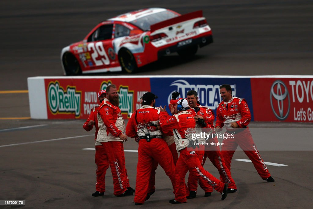 Crew members celebrate as <a gi-track='captionPersonalityLinkClicked' href=/galleries/search?phrase=Kevin+Harvick&family=editorial&specificpeople=209186 ng-click='$event.stopPropagation()'>Kevin Harvick</a>, driver of the #29 Budweiser Chevrolet, wins the NASCAR Sprint Cup Series AdvoCare 500 at Phoenix International Raceway on November 10, 2013 in Avondale, Arizona.