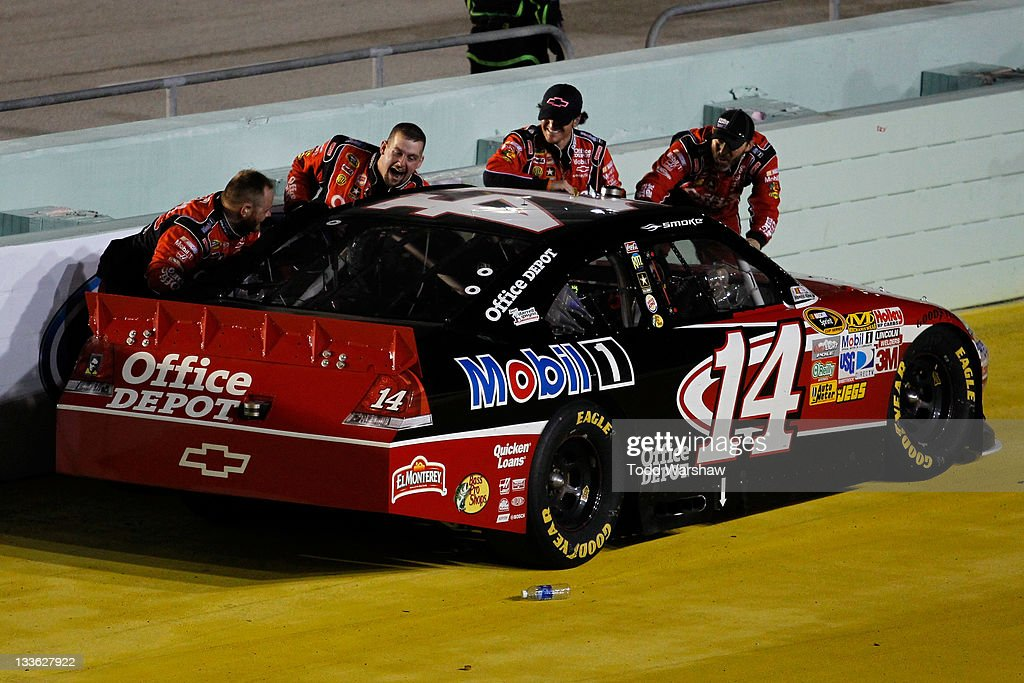 Crew members celebrate with <a gi-track='captionPersonalityLinkClicked' href=/galleries/search?phrase=Tony+Stewart+-+Race+Car+Driver&family=editorial&specificpeople=201686 ng-click='$event.stopPropagation()'>Tony Stewart</a>, driver of the #14 Office Depot/Mobil 1 Chevrolet, after winning the NASCAR Sprint Cup Series Ford 400 and the 2011 Series Championship at Homestead-Miami Speedway on November 20, 2011 in Homestead, Florida. Stewart wins his third NASCAR Championship.
