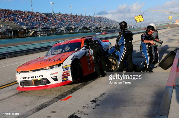 Crew members change the battery for Daniel Hemric driver of the Poppy Bank Chevrolet as he pits during the NASCAR XFINITY Series Championship Ford...