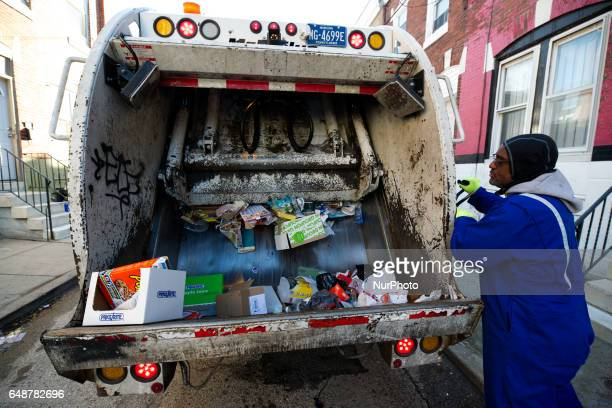 Crew members collect recycling from the curbside during a weekly route in South Philadelphia PA on February 13th 2017 After collection a full truck...