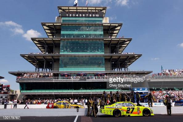 Crew members congratulate Paul Menard driver of the NIBCO/Menards Chevrolet in front of the pagoda after winning the NASCAR Sprint Cup Series...