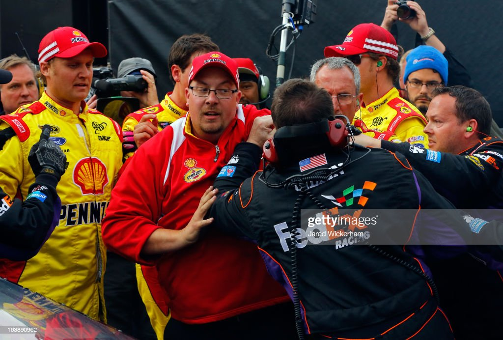 Crew members fight after Joey Logano, driver of the #22 Shell-Pennzoil Ford, had an altercation with Denny Hamlin (not pictured), driver of the #11 FedEx Freight Toyota, after the NASCAR Sprint Cup Series Food City 500 at Bristol Motor Speedway on March 17, 2013 in Bristol, Tennessee.