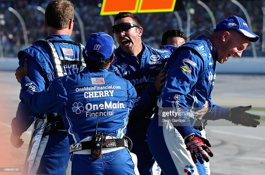 Crew members for Elliott Sadler, driver of the #11 OneMain Financial Toyota, celebrate after winning the NASCAR Nationwide Series Aaron's 312 at Talladega Superspeedway on May 3, 2014 in Talladega, Alabama.
