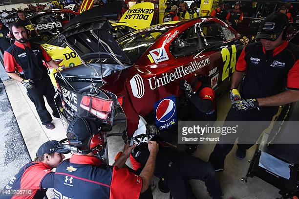 Crew members for Jeff Gordon driver of the AARP Member Advantages Chevrolet work on their car after an incident in the garage area with Clint Bowyer...