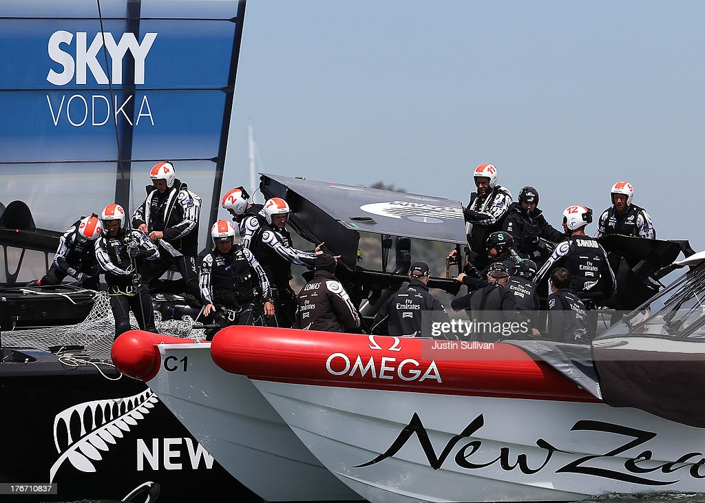 Crew members from Emirates Team New Zealand skippered by Dean Barker removed a section of tarp from their AC-72 catamaran that was damaged during race one of the Louis Vuitton Cup finals against Team Luna Rossa Challenge on August 17, 2013 in San Francisco, California. Emirates Team New Zealand won race one after Team Luna Rossa Challenge did not finish. The winner of the Louis Vuitton Cup goes on to race against Oracle Team USA in the America's Cup Finals that start on September 7.