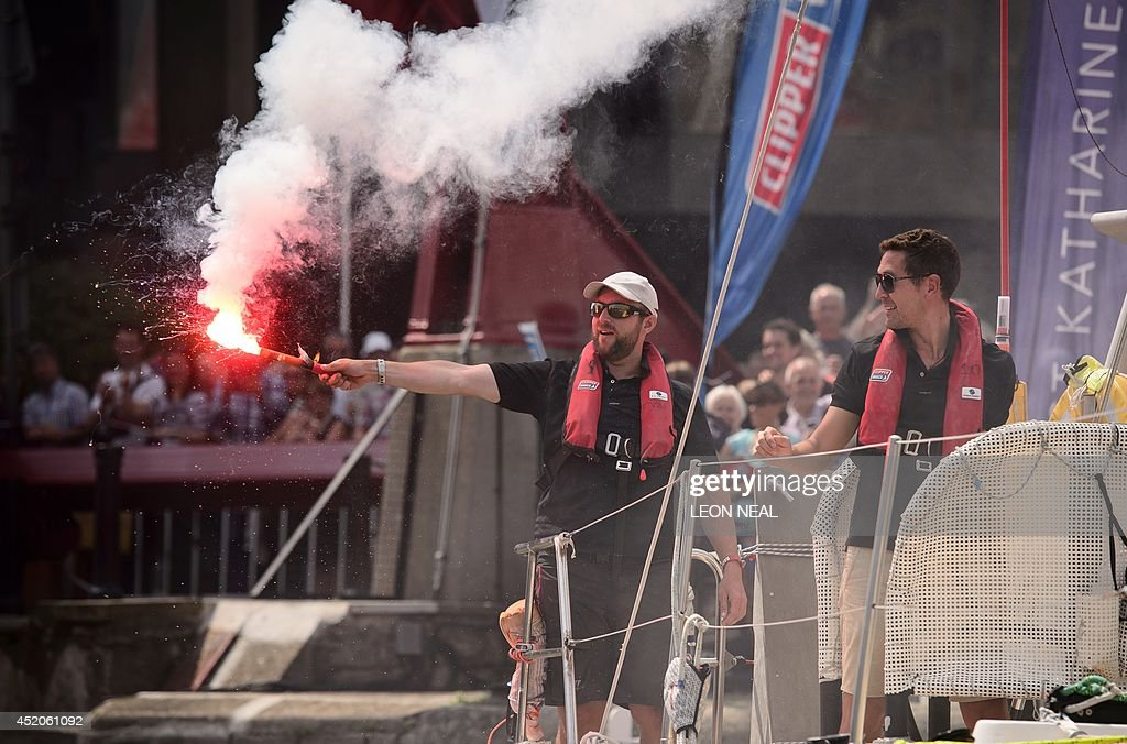 Crew members from the Henri Lloyd yacht celebrate as they sail into Saint Katherine's Dock in London, England after taking the first position in the 2013-14 Clipper Round the World Yacht Race, on July 12, 2014. The world's longest ocean race began on September 1, 2013, with a 12-strong fleet visiting 14 ports on six continents and travelling 40,000 miles before returning to the British capital. AFP PHOTO/Leon Neal