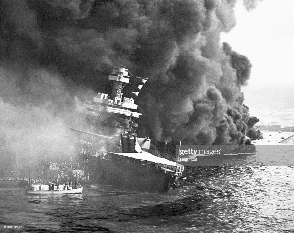 Crew members from the USS California abandon their burning ship after the Japanese attack on Pearl Harbor. December 7, 1941.