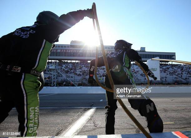 Crew members from the WinField United Toyota driven by Dakoda Armstrong race off of pit wall to complete a pit stop during the NASCAR XFINITY Series...