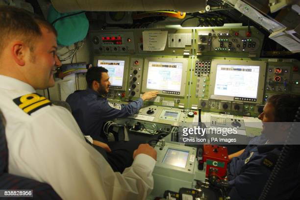 Crew members in the control room aboard the Royal Navy's newest and most advanced submarine HMS Astute in Southampton today where she has arrived for...