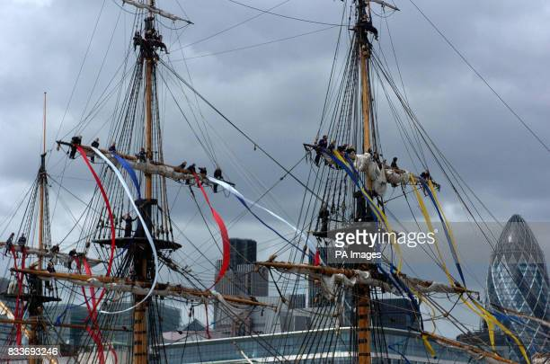Crew members let off streamers on the Swedish ship Gtheborg a fullscale replica of an 18th Century East India merchantman fires its cannons after...