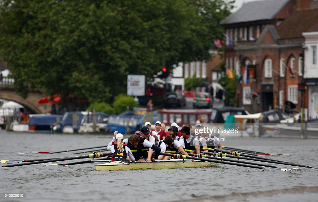 Crew members look exhausted after finishing during the Henley Royal Regatta on June 29, 2016 in Henley-on-Thames, England.