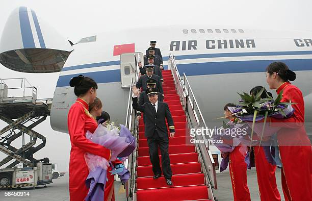 Crew members of a Boeing 747200 freighter of Air China which is bound for Frankfurt are welcomed during a ceremony to launch the cargo flight at...