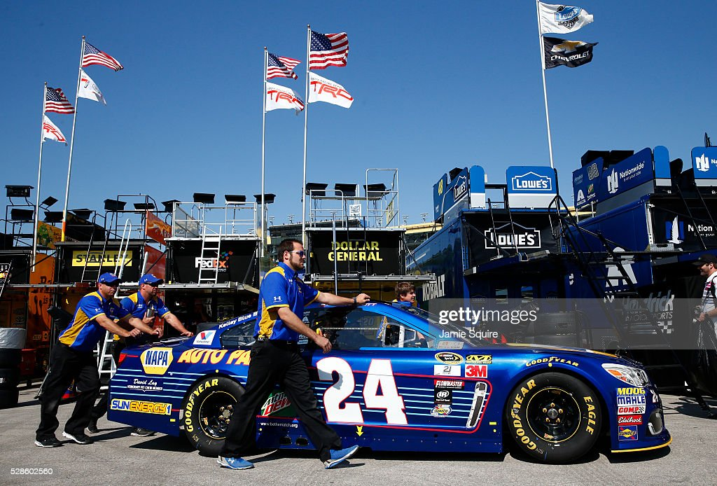 Crew members of Chase Elliott's, driver of the #24 NAPA Auto Parts Chevrolet, push the car during practice for the NASCAR Sprint Cup Series Go Bowling 400 at Kansas Speedway on May 6, 2016 in Kansas City, Kansas.