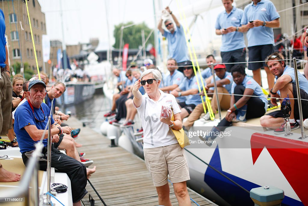 Crew members of one of the race yachts competing in The Clipper 2013-14 Round The World Yacht Race, listen to a race offical in St Katherine's Dock, east London on August 23, 2013. The 40,000 mile, 8-leg course begins on September 1 and will visit six continents, taking eleven months to complete.