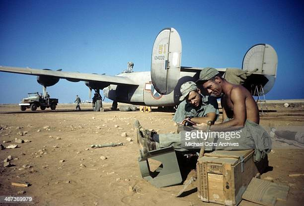 Crew members of the 376th Bombardment Group relax with a B24Liberator in the background at the US Air Force Base in Benghazi Libya