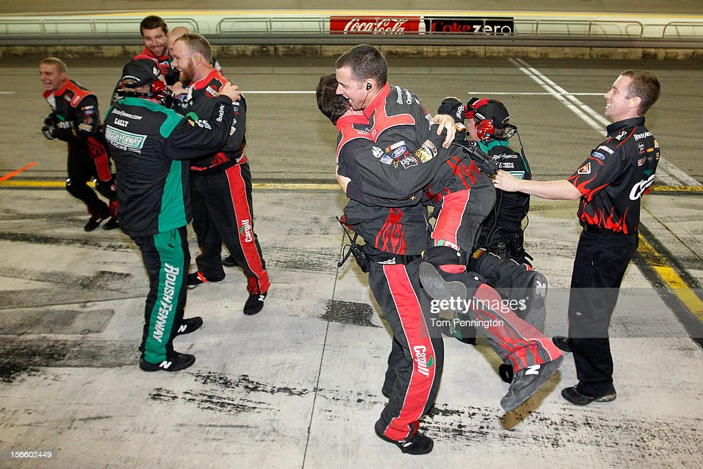 Crew members of the #6 Cargill Ford, driven by Ricky Stenhouse Jr., celebrate after winning the series championship and finishing sixth in the NASCAR Nationwide Series Ford EcoBoost 300 at Homestead-Miami Speedway on November 17, 2012 in Homestead, Florida.