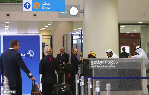 Crew members of the low cost Hungarian Wizz Air wait for their passports to be stamped at the newly opened AlMaktoum International airport the...