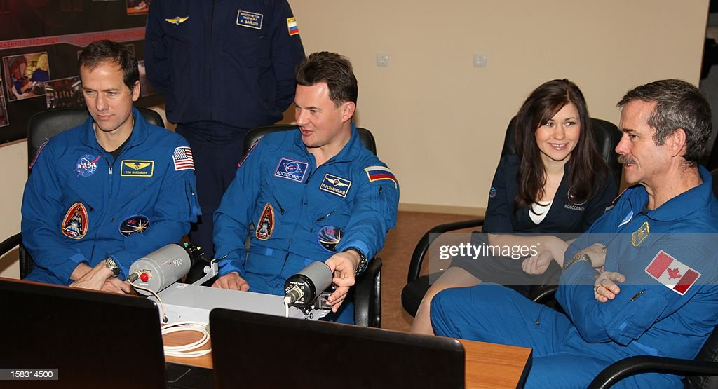 Crew members of the next expedition to the International Space Station (front R-L), Canadian astronaut Chris Hadfield, Russian cosmonaut Roman Romanenko and US astronaut Tom Marshburn, take part in the preflight preparation at the Russian leased Kazakhstan's Baikonur cosmodrome on December 13, 2012. Hadfield, Romanenko and Marshburn will join in December the remaining ISS crew, Russians Oleg Novitskiy and Evgeny Tarelkin, and Kevin Ford of the United States, who arrived there last month.